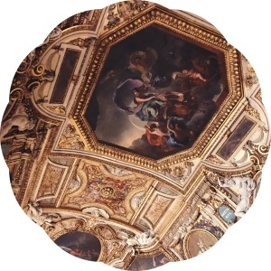 Oil paintings in gold frames on ceiling of the Louvre