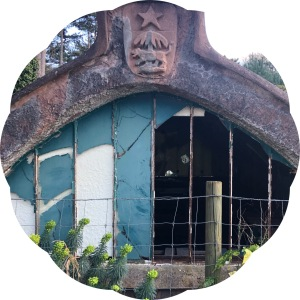 Degraded West African stone greenhouse with broken green windows